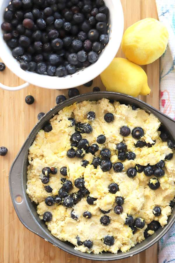 """einkorn scone in a 9""""baking pan with blueberries and lemons"""