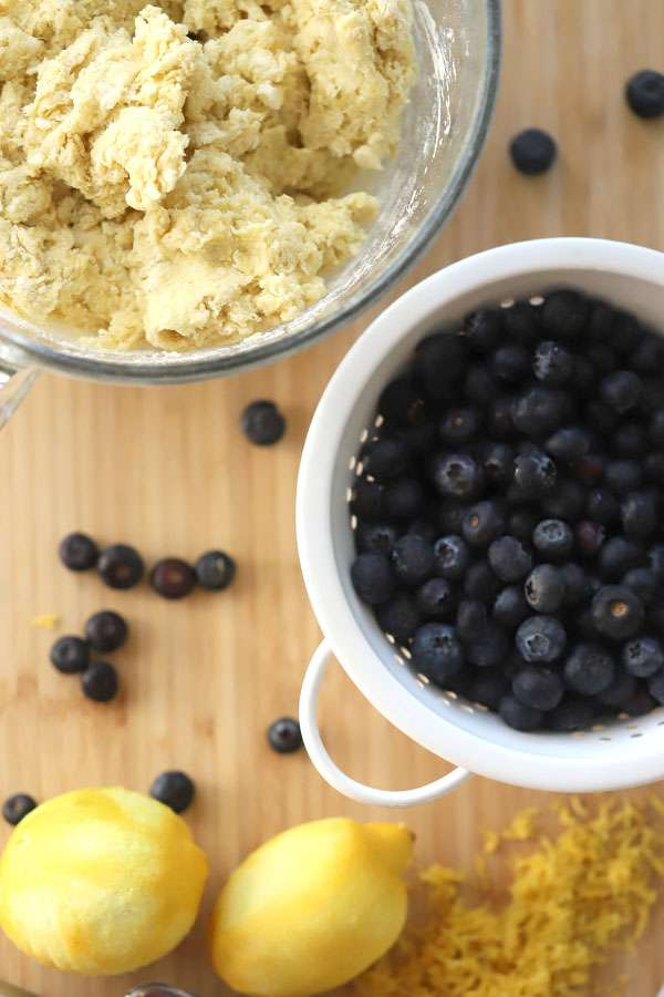 Einkorn Lemon Blueberry Scone dough in a bowl and a bowl of berries