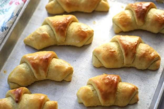 homemade einkorn dinner rolls on a baking sheet