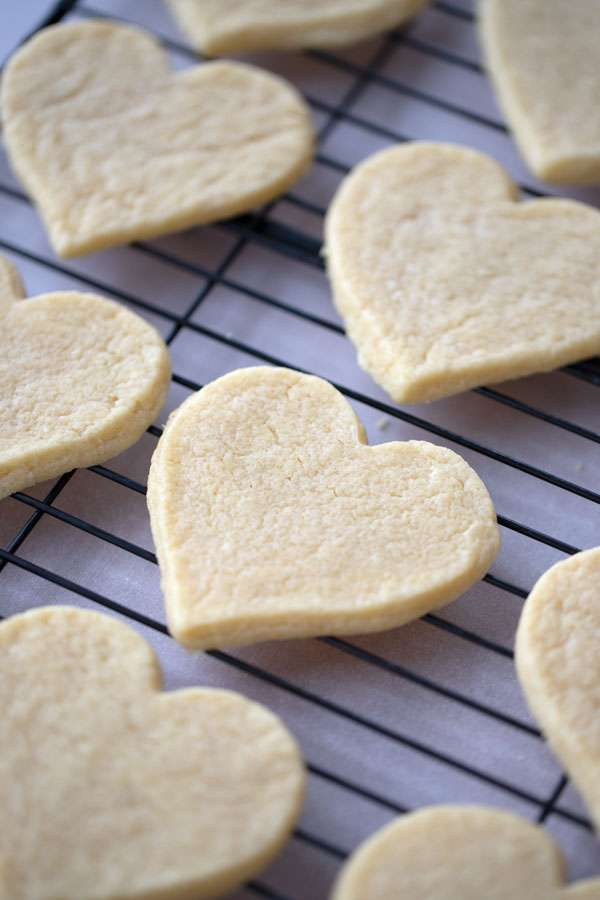 soft and chewy sugar cookies on a cooking rack